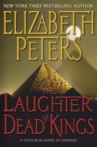 The Laughter of Dead Kings cover centers a pyramid. A second pyramid lurks in the background with a full moon overhead.