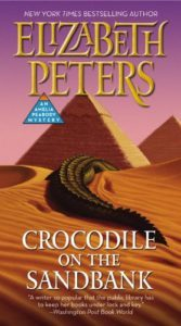 The Crocodile on the Sandbank cover shows a crocodile retreating over a sandbank with pyramids in the background.