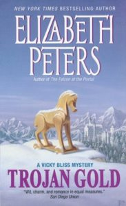 The cover of Troan Gold centers a Trojan horse in a snowy mountain landscape with a castle in the background.