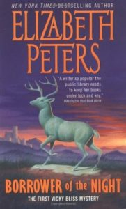 The cover of Borrower of the Night shows a statue of a stag.