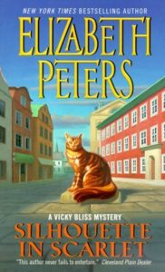 The cover of Silhouette in Scarlet features a shining statue of a housecat on a town street.